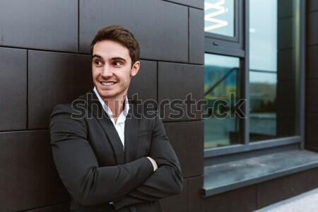Business man talking on phone near the office Stock photo © deandrobot