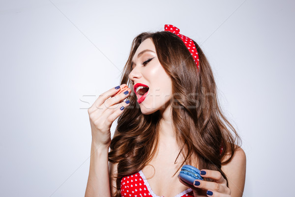 Girl eating confection Stock photo © deandrobot