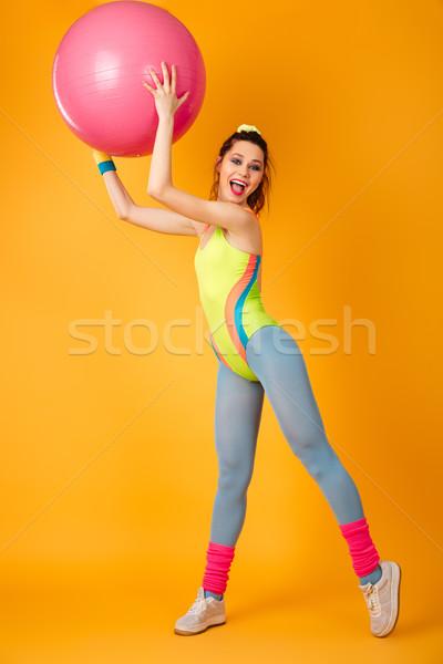 Genç spor kadın poz sarı uygunluk Stok fotoğraf © deandrobot