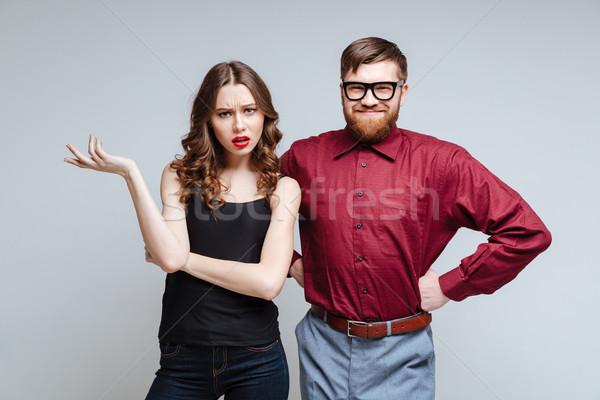 Surpreendido mulher sorrindo masculino nerd brasão Foto stock © deandrobot