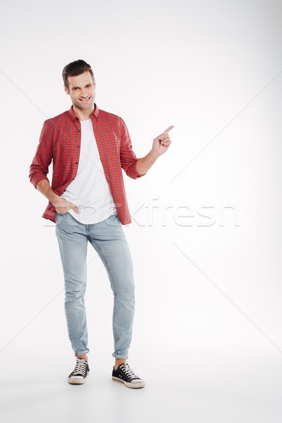 Vertical image of man pointing away Stock photo © deandrobot