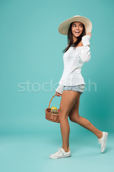 Elképesztő fiatal derűs hölgy pózol kék Stock fotó © deandrobot