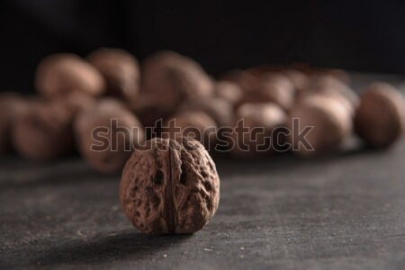 Photo of a walnut over dark background Stock photo © deandrobot