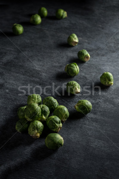 Brussels sprouts over dark background. Selective focus. Stock photo © deandrobot