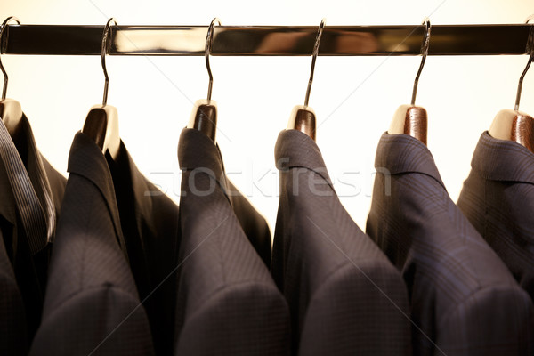 Imagen rack trajes tienda moda interior Foto stock © deandrobot