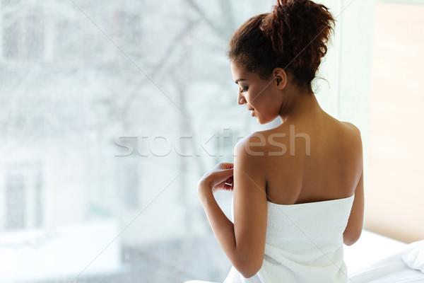 şaşırtıcı genç Afrika kadın havlu pencere Stok fotoğraf © deandrobot