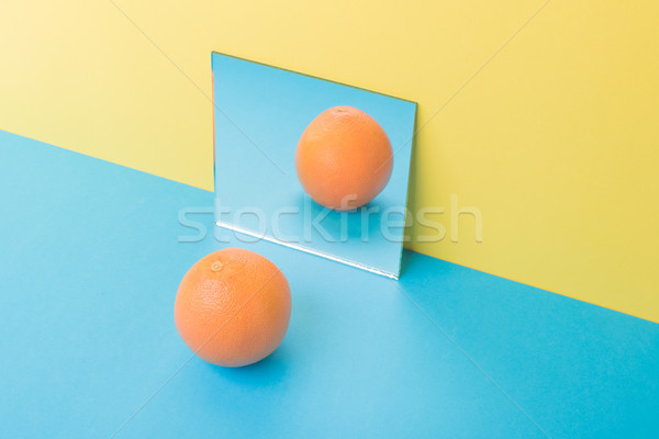 Grapefruit kék asztal izolált citromsárga kép Stock fotó © deandrobot