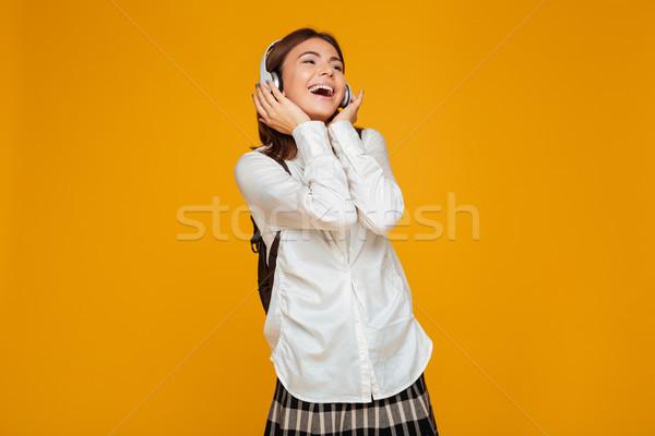 Portret szczęśliwy uczennica uniform słuchawki Zdjęcia stock © deandrobot
