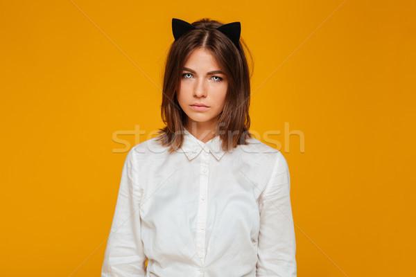 Infeliz adolescente aluna olhos azuis uniforme posando Foto stock © deandrobot