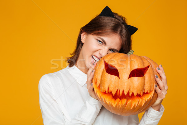 Emotional young woman dressed in crazy cat halloween costume Stock photo © deandrobot