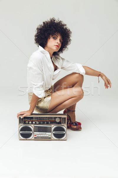 Pretty retro woman near boombox. Stock photo © deandrobot