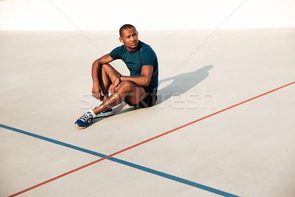 Portré fáradt afrikai fitnessz férfi fülhallgató Stock fotó © deandrobot