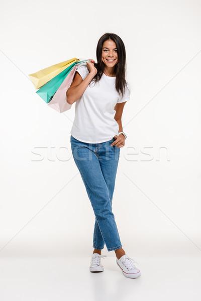 Teljes alakos portré boldog vonzó nő áll tart Stock fotó © deandrobot