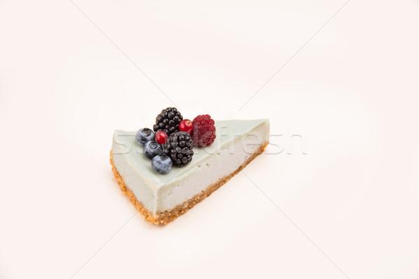 Vue de côté bleu cheesecake différent baies isolé Photo stock © deandrobot