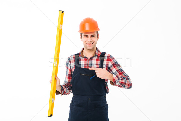 Full length portrait of a cheery young male builder Stock photo © deandrobot