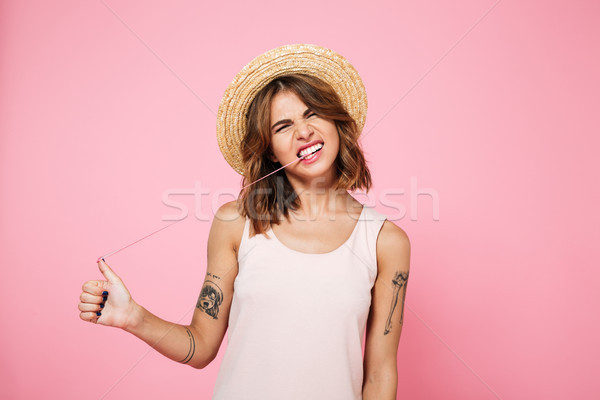 Portrait of a girl in summer playing with chewing gum Stock photo © deandrobot