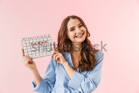 Portrait of an happy girl in summer hat pointing finger Stock photo © deandrobot