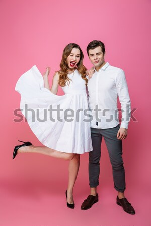 Full length photo of two cute happy woman standing on one leg an Stock photo © deandrobot