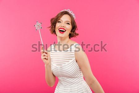 Overjoyed brunette woman with closed eyes holding sweet cupcake  Stock photo © deandrobot