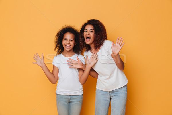 Portrait of two joyful african sisters Stock photo © deandrobot