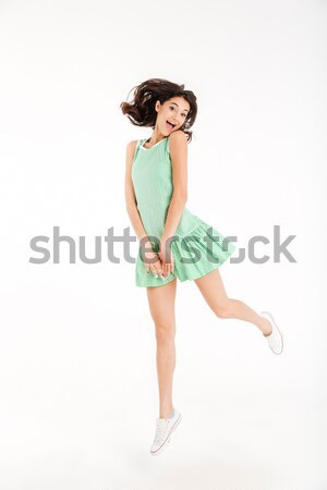 Full length portrait of a happy girl dressed in dress Stock photo © deandrobot