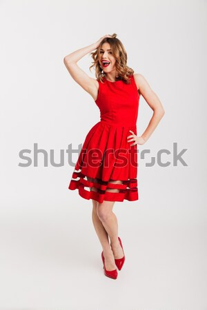 Full length portrait of a cheery petty girl Stock photo © deandrobot
