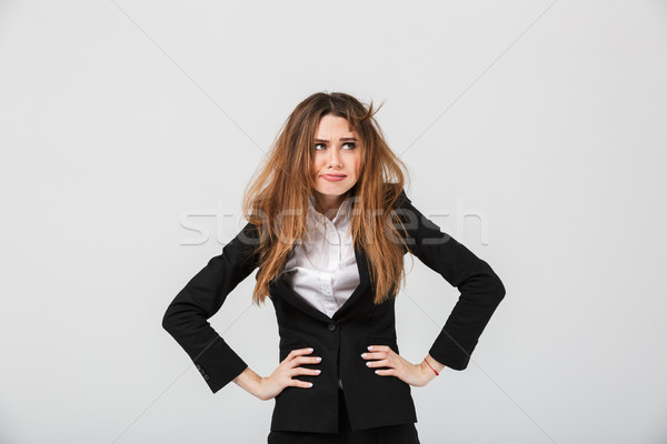 Portrait of a tired businesswoman dressed in suit Stock photo © deandrobot