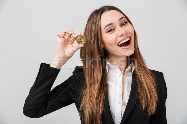 Sonriendo bastante dama traje mirando cámara Foto stock © deandrobot