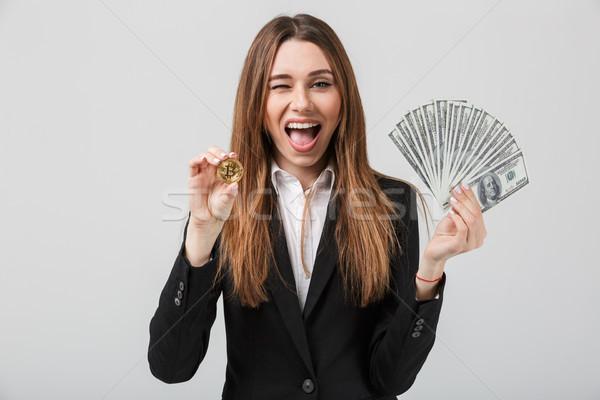 Portrait of a happy businesswoman dressed in suit Stock photo © deandrobot