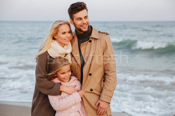 Portrait of a cheerful family with a little daughter Stock photo © deandrobot
