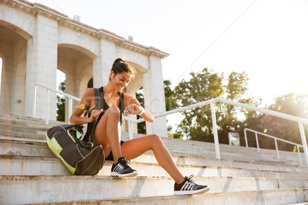 портрет счастливым сидят лестницы улице сумку Сток-фото © deandrobot