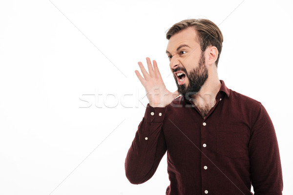 Close up portrait of a angry young bearded man Stock photo © deandrobot