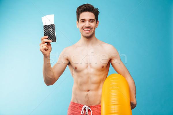 Portre gülen genç gömleksiz adam şişme Stok fotoğraf © deandrobot