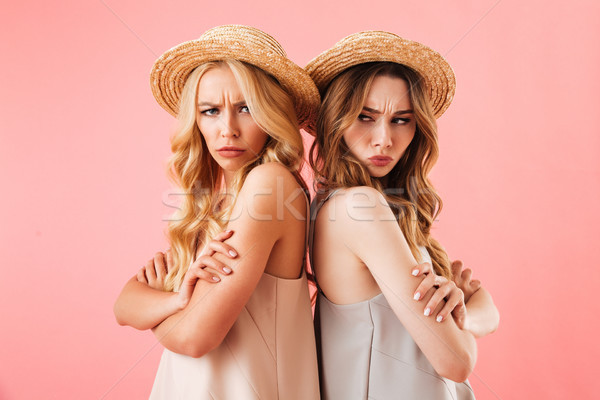 Portrait of two upset young women in summer clothes Stock photo © deandrobot