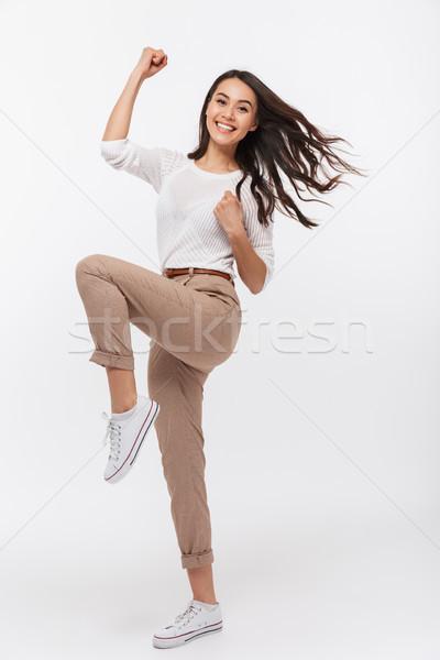 Teljes alakos portré mosolyog ázsiai üzletasszony ünnepel Stock fotó © deandrobot