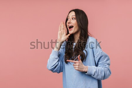 Portrait of a pretty young girl shouting loud Stock photo © deandrobot