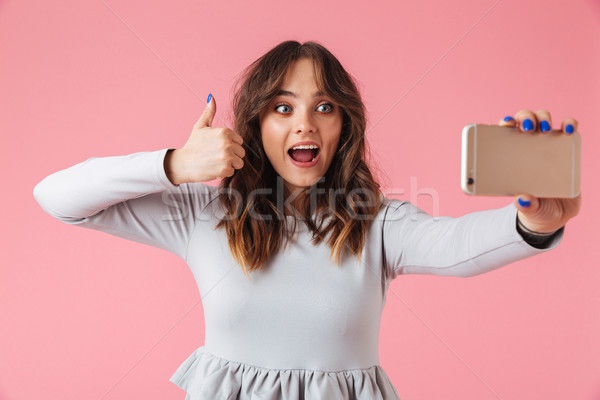 Portrait of a happy young girl taking selfie mobile phone Stock photo © deandrobot