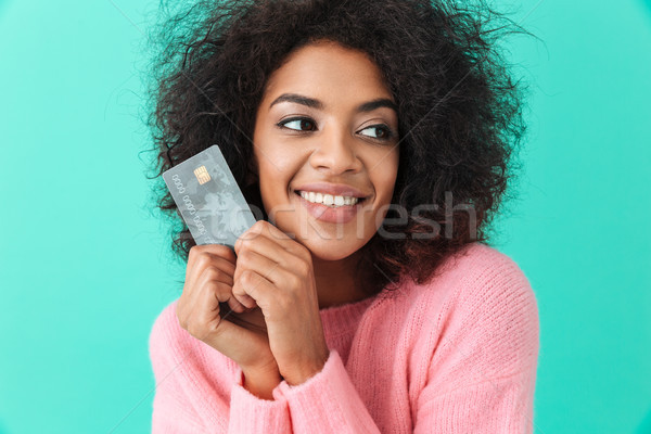 Portrait of content woman with shaggy hair holding plastic credi Stock photo © deandrobot
