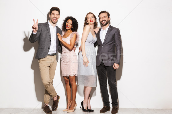 Group of happy well dressed multiracial people standing Stock photo © deandrobot