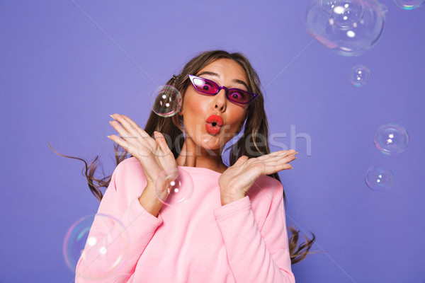 Image of european excited woman with two ponytails in sweatshirt Stock photo © deandrobot