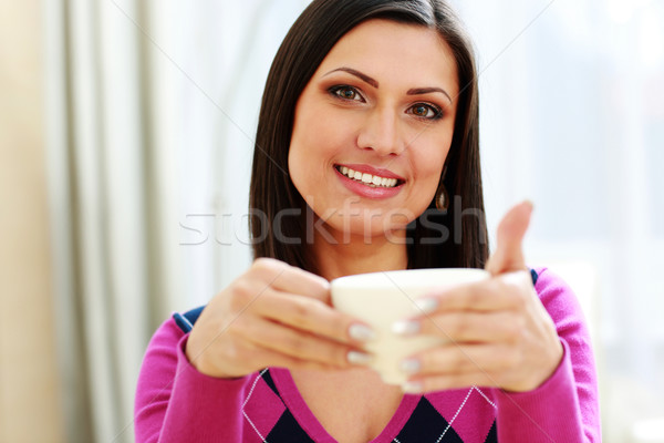 Middle-aged happy woman holding cup of coffee Stock photo © deandrobot