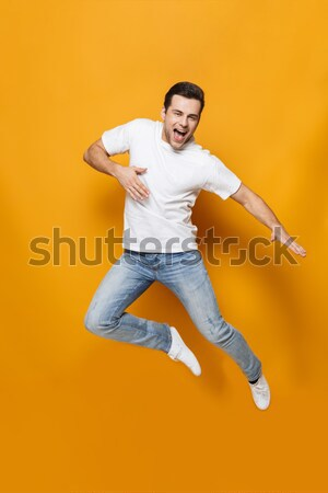 Laughing african man showing up on white background Stock photo © deandrobot