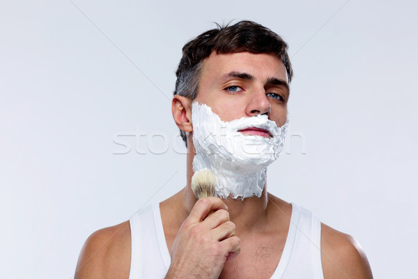 Man preparing to shave, applying shaving foam with a shaving brush Stock photo © deandrobot