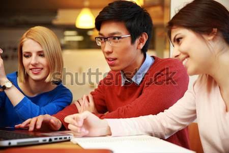 Gelukkig studenten huiswerk laptop samen meisje Stockfoto © deandrobot