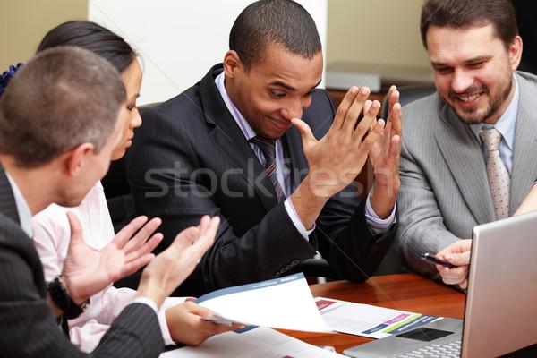 Többnemzetiségű üzleti csapat megbeszélés fókusz férfi lány Stock fotó © deandrobot