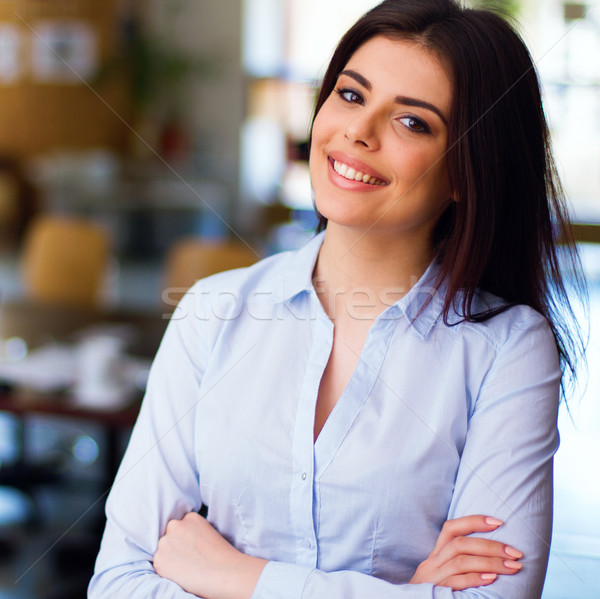 Modern business woman in the office Stock photo © deandrobot