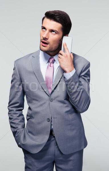 Aburrido empresario hablar teléfono gris tecnología Foto stock © deandrobot