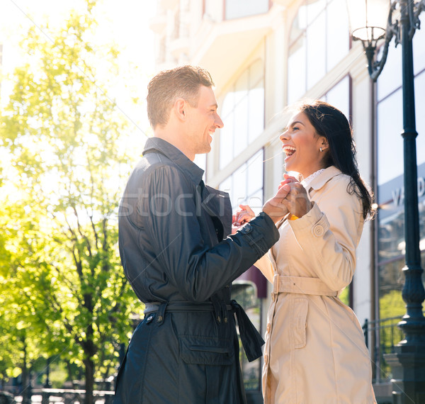 Laughing couple flirting outdoors Stock photo © deandrobot