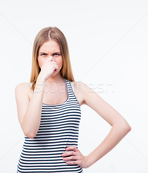 Young woman covering her nose with hand Stock photo © deandrobot