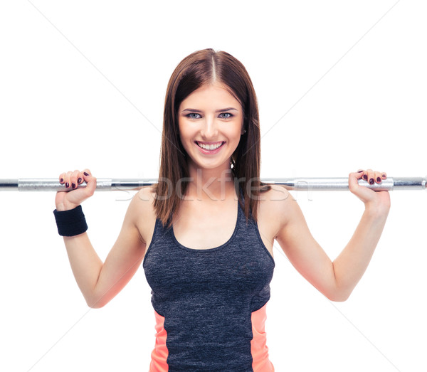 Smiling woman working out with barbell Stock photo © deandrobot